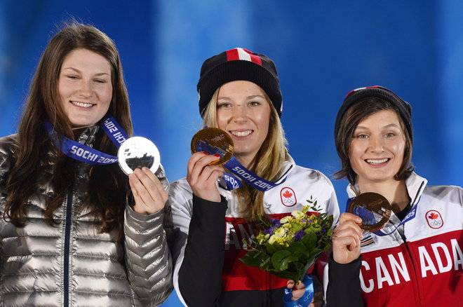 Gold medalist Dara Howell (C) of Canada is flanked by silver medalist Devin Logan (L) of USA and bronze winner Kim Lamarre of Canada during the medal ceremony for the Women's Freestyle Skiing Slopestyle final at the Sochi 2014 Olympic Games, Sochi, Russia, 11 February 2014. LARRY w. SMITH / EFE